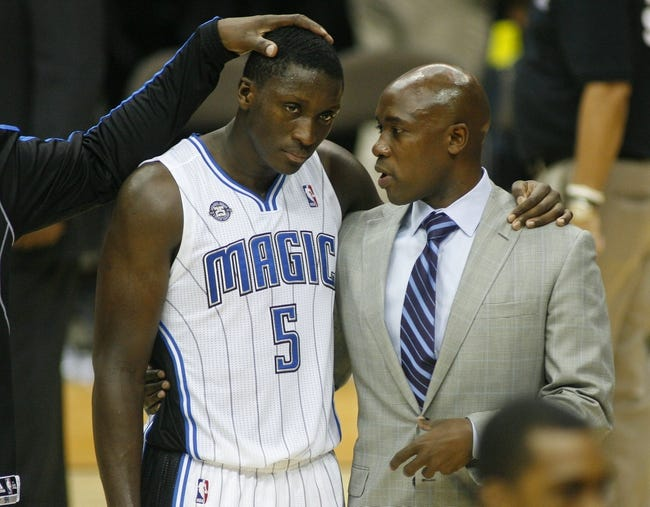 Oct 9, 2013; Jacksonville, FL, USA; Orlando Magic guard Victor Oladipo (5) is consoled by head coach Jacque Vaughn after their game against the New Orleans Pelicans at Jacksonville Veterans Memorial Arena. The New Orleans Pelicans beat the Orlando Magic 99-95. Mandatory Credit: Phil Sears-USA TODAY Sports