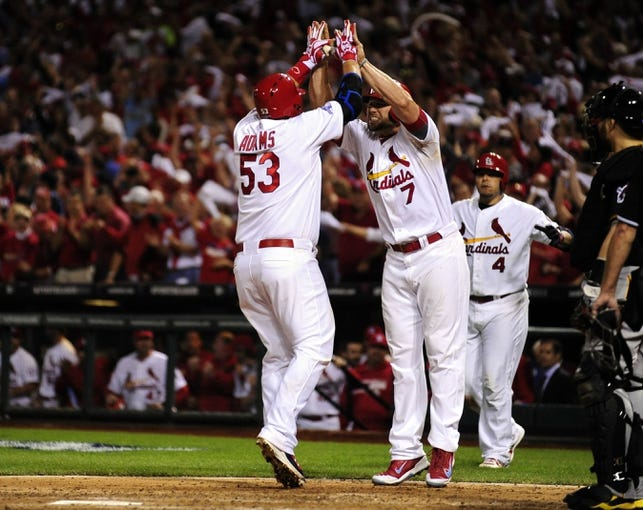 Oct 9, 2013; St. Louis, MO, USA; St. Louis Cardinals first baseman Matt Adams (53) celebrates with left fielder Matt Holliday (7) after hitting a 2-run home run against the Pittsburgh Pirates during the eighth inning in game five of the National League divisional series playoff baseball game at Busch Stadium. Mandatory Credit: Jeff Curry-USA TODAY Sports