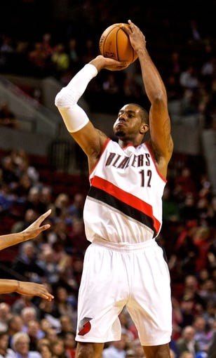 Oct 9, 2013; Portland, OR, USA; Portland Trail Blazers center LaMarcus Aldridge (12) shoots against the Phoenix Suns at the Moda Center. Mandatory Credit: Craig Mitchelldyer-USA TODAY Sports