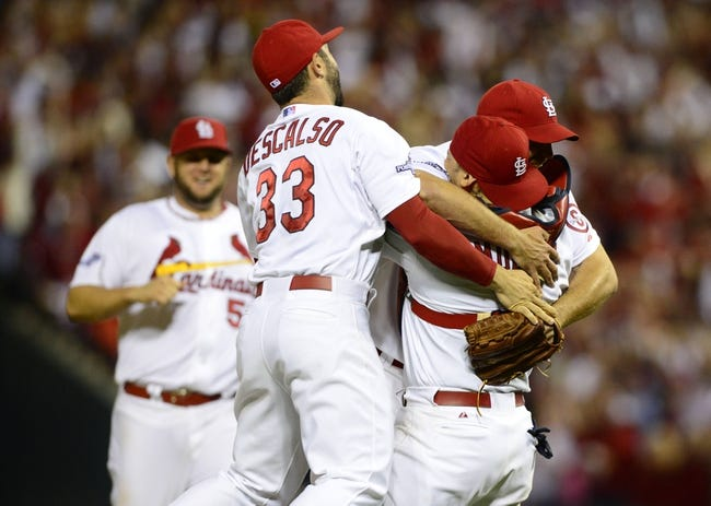 Oct 9, 2013; St. Louis, MO, USA; St. Louis Cardinals starting pitcher Adam Wainwright (50) celebrates shortstop Daniel Descalso (33) after defeating the Pittsburgh Pirates in game five of the National League divisional series playoff baseball game at Busch Stadium. The Cardinals won 6-1. Mandatory Credit: Jeff Curry-USA TODAY Sports
