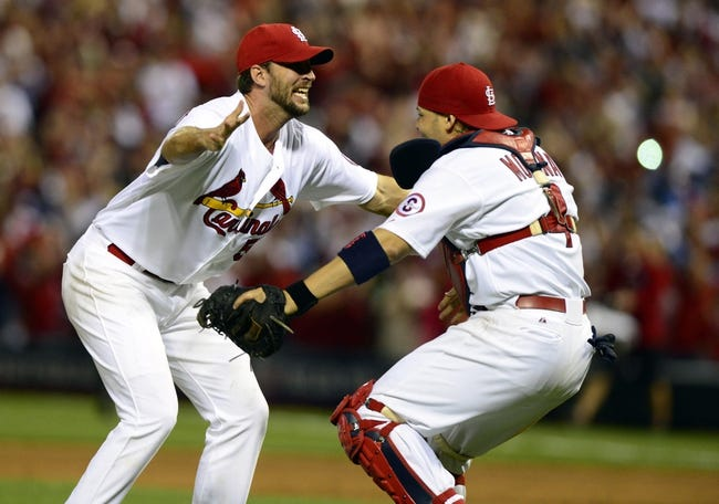 Oct 9, 2013; St. Louis, MO, USA; St. Louis Cardinals starting pitcher Adam Wainwright (50) celebrates with catcher Yadier Molina (4) after defeating the Pittsburgh Pirates in game five of the National League divisional series playoff baseball game at Busch Stadium. The Cardinals won 6-1. Mandatory Credit: Jeff Curry-USA TODAY Sports