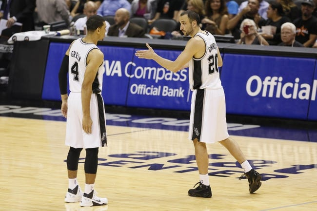 Oct 9, 2013; San Antonio, TX, USA; San Antonio Spurs guard Manu Ginobili (20) talks to Danny Green (4) during the second half agains the CSKA Moscow at the AT&T Center. The Spurs won 95-93 in overtime. Mandatory Credit: Soobum Im-USA TODAY Sports