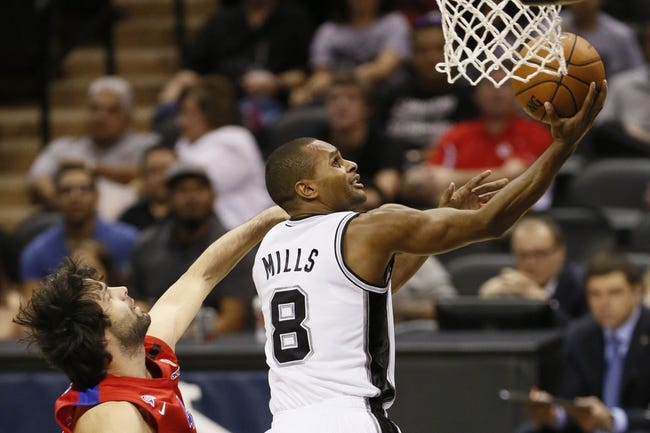 Oct 9, 2013; San Antonio, TX, USA; San Antonio Spurs guard Patrick Mills (8) drives to the basket against the CSKA Moscow during the second half at the AT&T Center. The Spurs won 95-93 in overtime. Mandatory Credit: Soobum Im-USA TODAY Sports