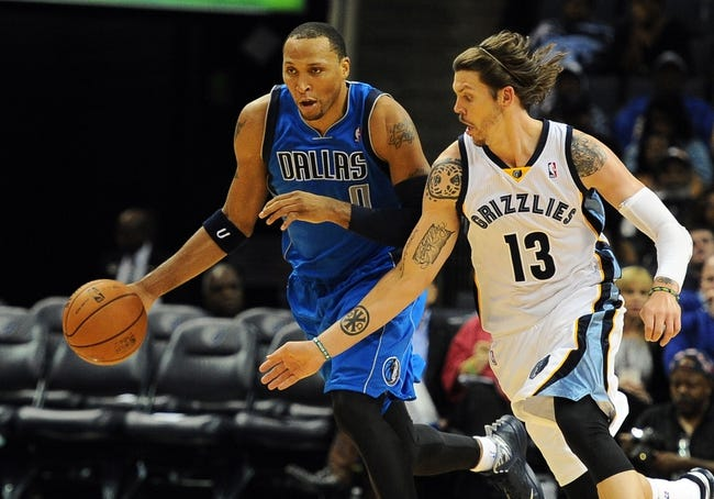 Oct 9, 2013; Memphis, TN, USA; Dallas Mavericks small forward Shawn Marion (0) handles the ball against Memphis Grizzlies small forward Mike Miller (13) during the third quarter at FedExForum. Dallas Mavericks defeated Memphis Grizzlies 95-90. Mandatory Credit: Justin Ford-USA TODAY Sports