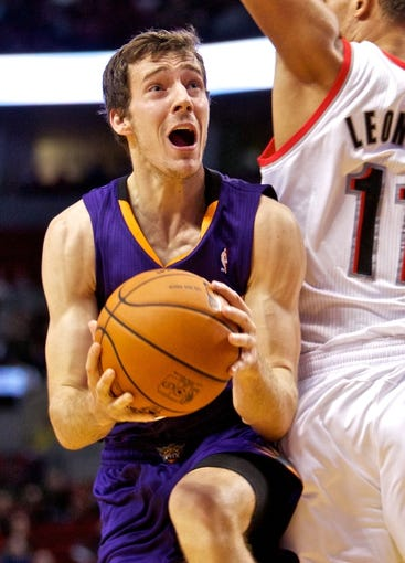 Oct 9, 2013; Portland, OR, USA; Phoenix Suns point guard Goran Dragic (1) drives to the basket past Portland Trail Blazers center Meyers Leonard (11) at the Moda Center. Mandatory Credit: Craig Mitchelldyer-USA TODAY Sports