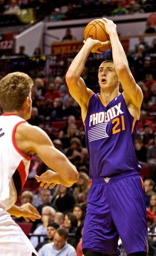 Oct 9, 2013; Portland, OR, USA; Phoenix Suns center Alex Len (21) shoots over Portland Trail Blazers center Meyers Leonard (11) at the Moda Center. Mandatory Credit: Craig Mitchelldyer-USA TODAY Sports
