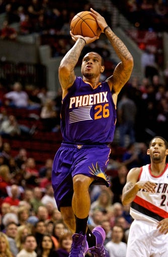 Oct 9, 2013; Portland, OR, USA; Phoenix Suns point guard Shannon Brown (26) shoots over Portland Trail Blazers shooting guard Allen Crabbe (23) at the Moda Center. Mandatory Credit: Craig Mitchelldyer-USA TODAY Sports