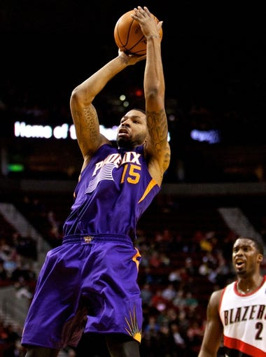 Oct 9, 2013; Portland, OR, USA; Phoenix Suns power forward Marcus Morris (15) shoots in the second quarter against the Portland Trail Blazers at the Moda Center. Mandatory Credit: Craig Mitchelldyer-USA TODAY Sports