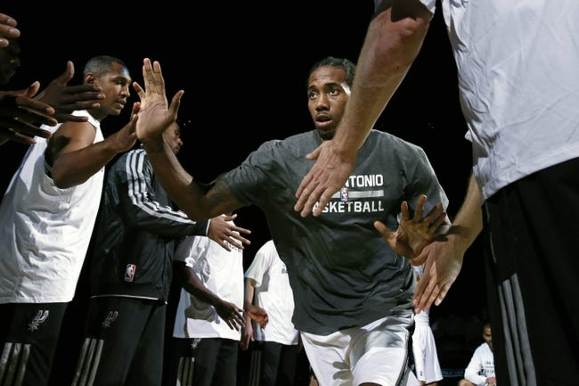Oct 9, 2013; San Antonio, TX, USA; San Antonio Spurs forward Kawhi Leonard (2) is introduced before the game against the CSKA Moscow at the AT&T Center. Mandatory Credit: Soobum Im-USA TODAY Sports