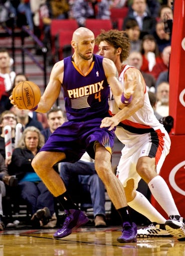 Oct 9, 2013; Portland, OR, USA; Phoenix Suns center Marcin Gortat (4) posts up against Portland Trail Blazers center Robin Lopez (42) at the Moda Center. Mandatory Credit: Craig Mitchelldyer-USA TODAY Sports