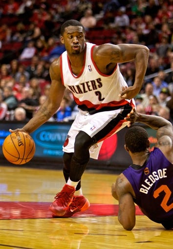 Oct 9, 2013; Portland, OR, USA; Portland Trail Blazers shooting guard Wesley Matthews (2) drives around Phoenix Suns point guard Eric Bledsoe (2) at the Moda Center. Mandatory Credit: Craig Mitchelldyer-USA TODAY Sports