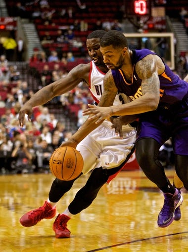 Oct 9, 2013; Portland, OR, USA; Phoenix Suns power forward Markieff Morris (11) steals the ball from Portland Trail Blazers shooting guard Wesley Matthews (2) at the Moda Center. Mandatory Credit: Craig Mitchelldyer-USA TODAY Sports