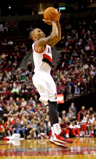 Oct 9, 2013; Portland, OR, USA; Portland Trail Blazers point guard Damian Lillard (0) shoots the ball against the Phoenix Suns at the Moda Center. Mandatory Credit: Craig Mitchelldyer-USA TODAY Sports