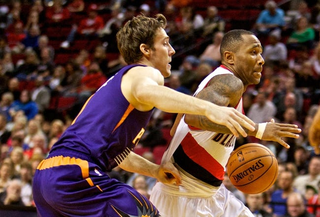 Oct 9, 2013; Portland, OR, USA; Portland Trail Blazers point guard Mo Williams (25) drives past Phoenix Suns point guard Goran Dragic (1) at the Moda Center. Mandatory Credit: Craig Mitchelldyer-USA TODAY Sports