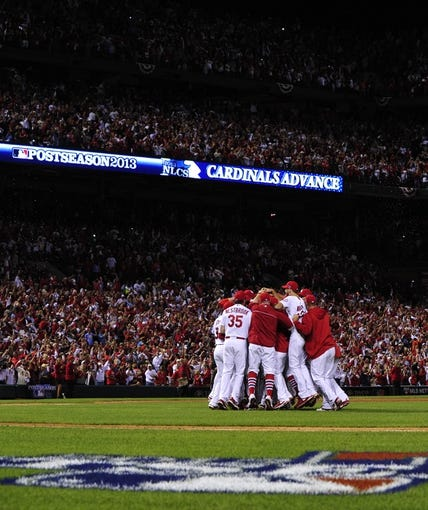 Oct 9, 2013; St. Louis, MO, USA; The St. Louis Cardinals celebrates after defeating the Pittsburgh Pirates in game five of the National League divisional series playoff baseball game at Busch Stadium. The Cardinals won 6-1. Mandatory Credit: Scott Rovak-USA TODAY Sports