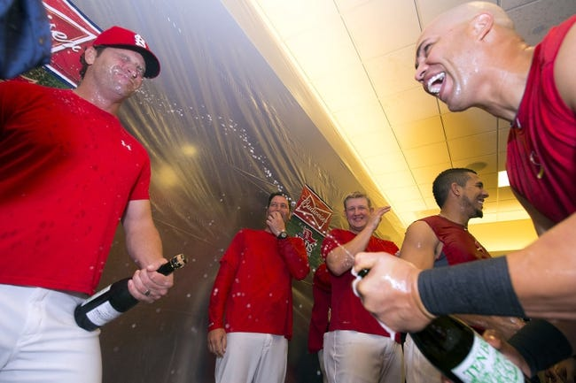 Oct 9, 2013; St. Louis, MO, USA; St. Louis Cardinals manager Mike Matheny (left) and right fielder Carlos Beltran (right)  celebrates after defeating the Pittsburgh Pirates in game five of the National League divisional series playoff baseball game at Busch Stadium. The Cardinals won 6-1. Mandatory Credit: Scott Rovak-USA TODAY Sports