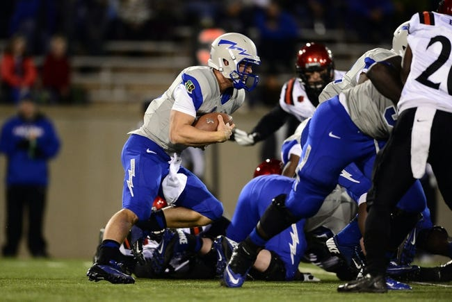 Oct 10, 2013; Colorado Springs, CO, USA; Air Force Falcons quarterback Karson Roberts (16) runs with the football in the first quarter against the San Diego State Aztecs at Falcon Stadium. Mandatory Credit: Ron Chenoy-USA TODAY Sports