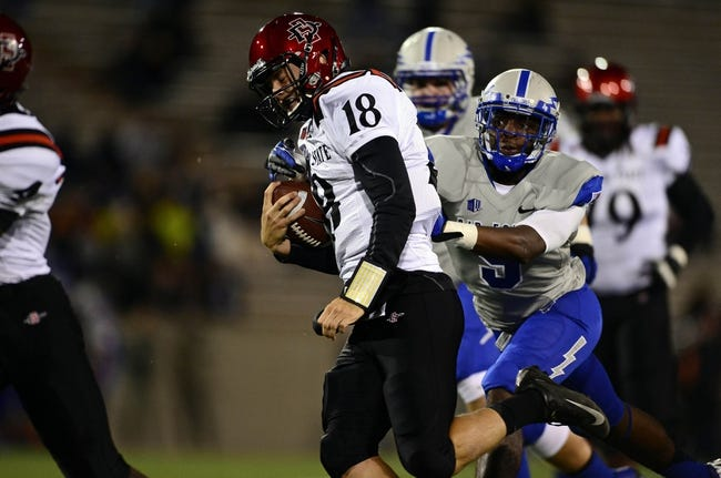 Oct 10, 2013; Colorado Springs, CO, USA; Air Force Falcons cornerback Christian Linn (9) attempts to tackle San Diego State Aztecs quarterback Quinn Kaehler (18) in the first quarter at Falcon Stadium. Mandatory Credit: Ron Chenoy-USA TODAY Sports