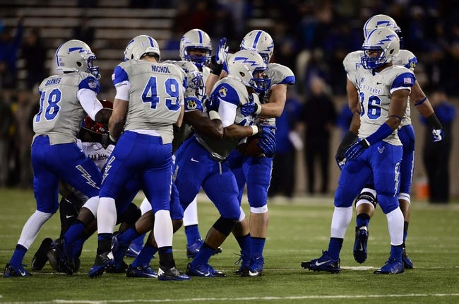 Oct 10, 2013; Colorado Springs, CO, USA; Air Force Falcons linebacker Kristov George (42) (center) reacts after his second quarter interception against the San Diego State Aztecs at Falcon Stadium. Mandatory Credit: Ron Chenoy-USA TODAY Sports