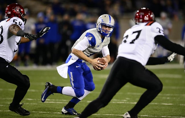 Oct 10, 2013; Colorado Springs, CO, USA; Air Force Falcons quarterback Nate Romine (6) scrambles with the football in the second quarter against the San Diego State Aztecs at Falcon Stadium. Mandatory Credit: Ron Chenoy-USA TODAY Sports