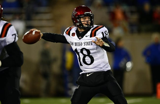 Oct 10, 2013; Colorado Springs, CO, USA; San Diego State Aztecs quarterback Quinn Kaehler (18) prepares to pass in the second quarter against the Air Force Falcons at Falcon Stadium. Mandatory Credit: Ron Chenoy-USA TODAY Sports