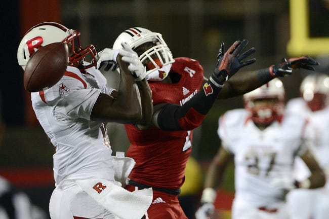 Oct 10, 2013; Louisville, KY, USA; Rutgers Scarlet Knights defensive back Jeremy Deering (18) breaks up a pass intended for Louisville Cardinals wide receiver Michaelee Harris (2) during the second half at Papa John's Cardinal Stadium. Louisville defeated Rutgers 24-10.  Mandatory Credit: Jamie Rhodes-USA TODAY Sports