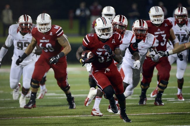 Oct 10, 2013; Louisville, KY, USA; Louisville Cardinals running back Senorise Perry (32) runs the ball against the Rutgers Scarlet Knights during the second half at Papa John's Cardinal Stadium. Louisville defeated Rutgers 24-10.  Mandatory Credit: Jamie Rhodes-USA TODAY Sports