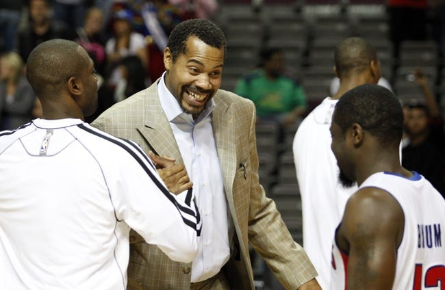 Oct 10, 2013; Auburn Hills, MI, USA; Detroit Pistons player development coach Rasheed Wallace (middle) shakes hands with Miami Heat shooting guard Dwyane Wade (left) after the game at The Palace of Auburn Hills. Heat beat the Pistons 112-107. Mandatory Credit: Raj Mehta-USA TODAY Sports