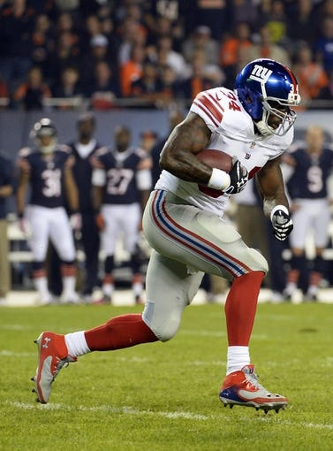 Oct 10, 2013; Chicago, IL, USA; New York Giants running back Brandon Jacobs (34) rushes the ball against the Chicago Bears during the first half at Soldier Field. Mandatory Credit: Mike DiNovo-USA TODAY Sports
