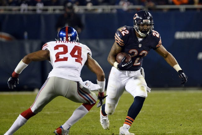 Oct 10, 2013; Chicago, IL, USA; Chicago Bears running back Matt Forte (22) rushes the ball against New York Giants defensive back Terrell Thomas (24) during the second half at Soldier Field. Chicago defeats New York 27-21. Mandatory Credit: Mike DiNovo-USA TODAY Sports