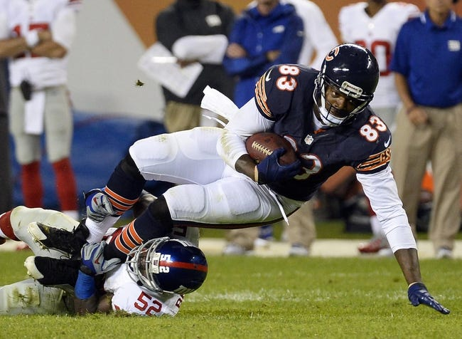Oct 10, 2013; Chicago, IL, USA; Chicago Bears tight end Martellus Bennett (83) makes a catch against New York Giants outside linebacker Jon Beason (52) during the second half at Soldier Field. Chicago defeats New York 27-21. Mandatory Credit: Mike DiNovo-USA TODAY Sports