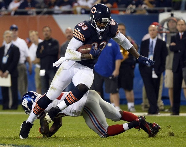 Oct 10, 2013; Chicago, IL, USA; Chicago Bears tight end Martellus Bennett (83) makes a catch against New York Giants cornerback Prince Amukamara (20) during the second half at Soldier Field. Chicago defeats New York 27-21. Mandatory Credit: Mike DiNovo-USA TODAY Sports