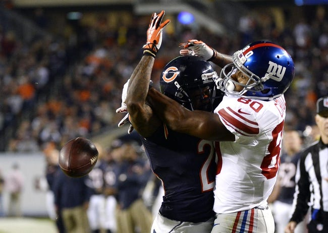 Oct 10, 2013; Chicago, IL, USA; Chicago Bears cornerback Tim Jennings (26) is flagged for interference against New York Giants wide receiver Victor Cruz (80) during the second half at Soldier Field. Chicago defeats New York 27-21. Mandatory Credit: Mike DiNovo-USA TODAY Sports