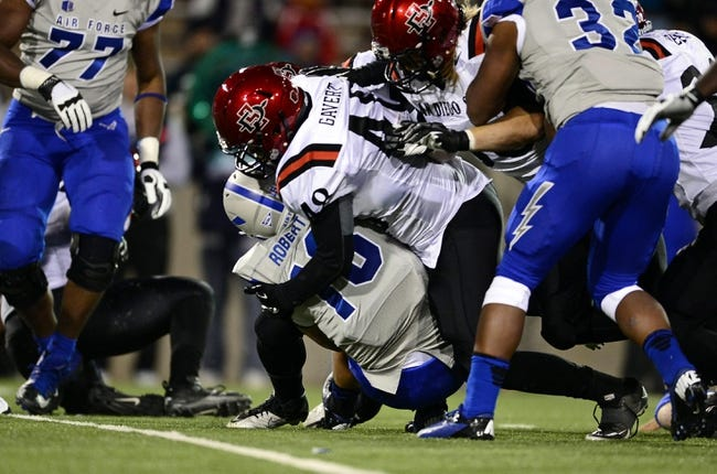Oct 10, 2013; Colorado Springs, CO, USA; Air Force Falcons quarterback Karson Roberts (16) is tackled by San Diego State Aztecs linebacker Josh Gavert (48) in the first quarter at Falcon Stadium. Mandatory Credit: Ron Chenoy-USA TODAY Sports