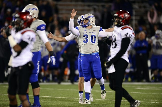 Oct 10, 2013; Colorado Springs, CO, USA; Air Force Falcons kicker Will Conant (30) is congratulated by punter David Baska (19) after his forty nine yard field goal late in the second quarter against the San Diego State Aztecs at Falcon Stadium. Mandatory Credit: Ron Chenoy-USA TODAY Sports