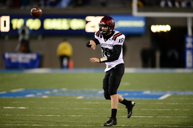 Oct 10, 2013; Colorado Springs, CO, USA; San Diego State Aztecs quarterback Quinn Kaehler (18) passes in the fourth quarter against the Air Force Falcons at Falcon Stadium. The Aztecs defeated the Falcons 27-20. Mandatory Credit: Ron Chenoy-USA TODAY Sports