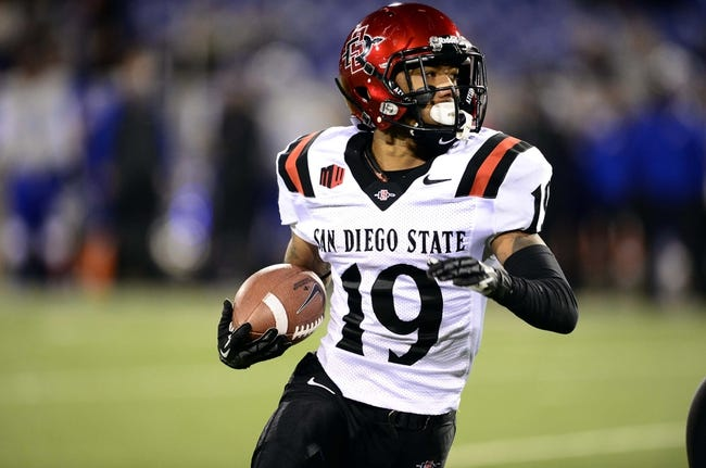 Oct 10, 2013; Colorado Springs, CO, USA; San Diego State Aztecs running back Donnel Pumphrey (19) runs in the fourth quarter against the Air Force Falcons at Falcon Stadium. The Aztecs defeated the Falcons 27-20. Mandatory Credit: Ron Chenoy-USA TODAY Sports