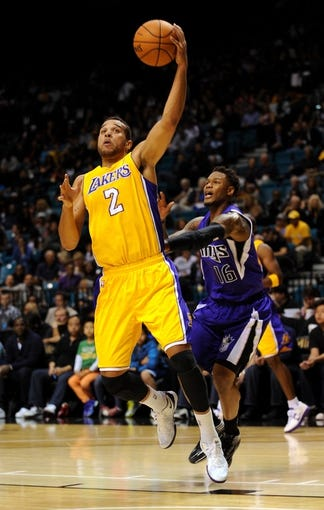 Oct 10, 2013; Las Vegas, NV, USA; Los Angeles Lakers forward Elias Harris (2) leaps to control an offensive rebound above Sacramento Kings guard Ben McLemore (16) during an NBA preseason game at MGM Grand Arena. The Kings won the game 104-86. Mandatory Credit: Stephen R. Sylvanie-USA TODAY Sports