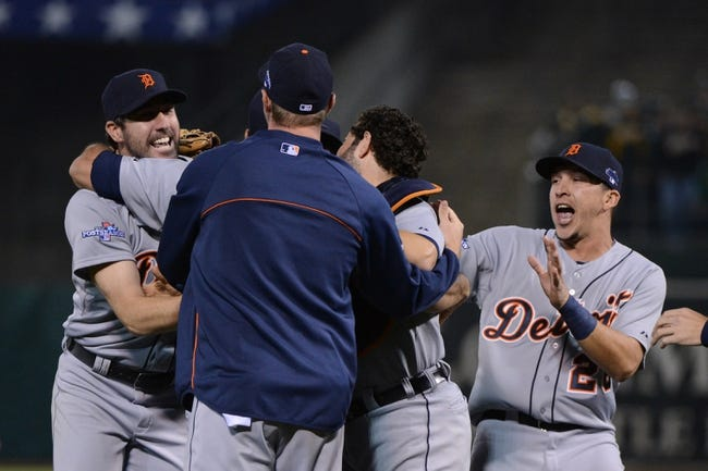 October 10, 2013; Oakland, CA, USA; Detroit Tigers starting pitcher Justin Verlander (35, far left) is celebrates with teammates after game five of the American League divisional series playoff baseball game against the Oakland Athletics at O.co Coliseum. The Tigers defeated the Athletics 3-0. Mandatory Credit: Kyle Terada-USA TODAY Sports