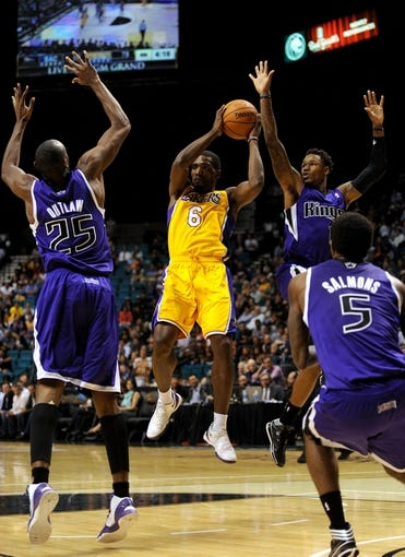 Oct 10, 2013; Las Vegas, NV, USA;  Los Angeles Lakers guard Darius Johnson-Odom (6) leaps to pass the ball away from being triple covered by Sacramento Kings forward Travis Outlaw (25), guard Ben McLemore (16), and forward John Salmons (5) during an NBA preseason game at MGM Grand Arena. The Kings won the game 104-86. Mandatory Credit: Stephen R. Sylvanie-USA TODAY Sports