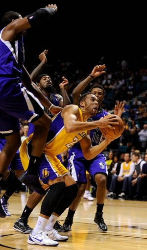 Oct 10, 2013; Las Vegas, NV, USA; Los Angeles Lakers forward Elias Harris battles for position under the basket against several Sacramento Kings players during an NBA preseason game at MGM Grand Arena. The Kings won the game 104-86. Mandatory Credit: Stephen R. Sylvanie-USA TODAY Sports