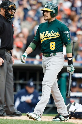 Oct 7, 2013; Detroit, MI, USA; Oakland Athletics shortstop Jed Lowrie (8) walks back to the dugout after striking out against the Detroit Tigers in game three of the American League divisional series playoff baseball game at Comerica Park. Mandatory Credit: Rick Osentoski-USA TODAY Sports