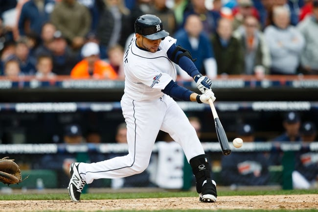 Oct 7, 2013; Detroit, MI, USA; Detroit Tigers second baseman Omar Infante (4) at bat against the Oakland Athletics in game three of the American League divisional series playoff baseball game at Comerica Park. Mandatory Credit: Rick Osentoski-USA TODAY Sports