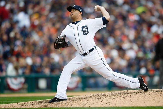 Oct 7, 2013; Detroit, MI, USA; Detroit Tigers relief pitcher Jose Alvarez (52) pitches in the fifth inning against the Oakland Athletics in game three of the American League divisional series playoff baseball game at Comerica Park. Mandatory Credit: Rick Osentoski-USA TODAY Sports