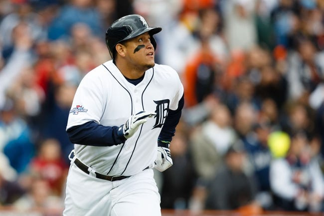Oct 7, 2013; Detroit, MI, USA; Detroit Tigers third baseman Miguel Cabrera (24) runs to first against the Oakland Athletics in game three of the American League divisional series playoff baseball game at Comerica Park. Mandatory Credit: Rick Osentoski-USA TODAY Sports