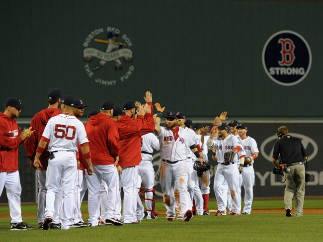 Oct 5, 2013; Boston, MA, USA; The Boston Red Sox celebrate their victory over the Tampa Bay Rays in game two of the American League divisional series playoff baseball game at Fenway Park. Mandatory Credit: Bob DeChiara-USA TODAY Sports