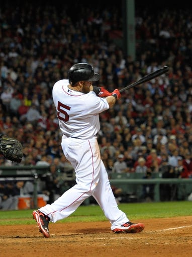 Oct 5, 2013; Boston, MA, USA; Boston Red Sox left fielder Jonny Gomes (5) bats during the fifth inning in game two of the American League divisional series playoff baseball game against the Tampa Bay Rays at Fenway Park. Mandatory Credit: Bob DeChiara-USA TODAY Sports
