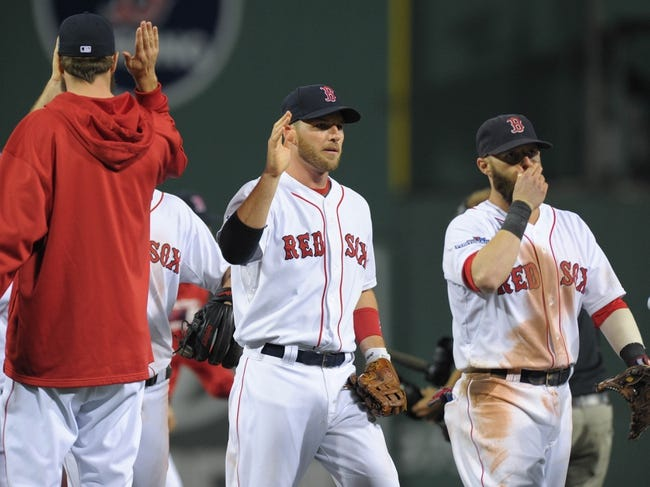 Oct 5, 2013; Boston, MA, USA; Boston Red Sox shortstop Stephen Drew (7) high fives his teammate after defeating the Tampa Bay Rays in game two of the American League divisional series playoff baseball game at Fenway Park. Mandatory Credit: Bob DeChiara-USA TODAY Sports
