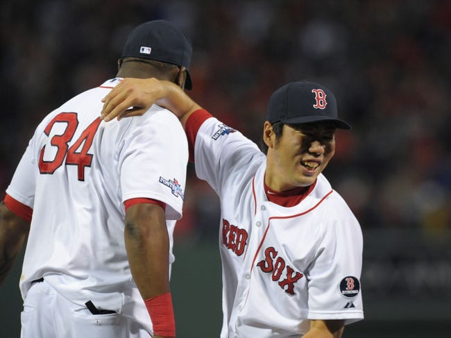 Oct 5, 2013; Boston, MA, USA; Boston Red Sox designated hitter David Ortiz (34) and relief pitcher Koji Uehara (19) celebrate after defeating the Tampa Bay Rays in game two of the American League divisional series playoff baseball game at Fenway Park. Mandatory Credit: Bob DeChiara-USA TODAY Sports