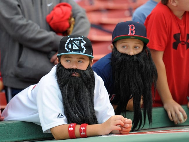 Oct 5, 2013; Boston, MA, USA; A fan wearing a beard waits for the start of game two of the American League divisional series playoff baseball game between the Boston Red Sox and the Tampa Bay Rays at Fenway Park. Mandatory Credit: Bob DeChiara-USA TODAY Sports